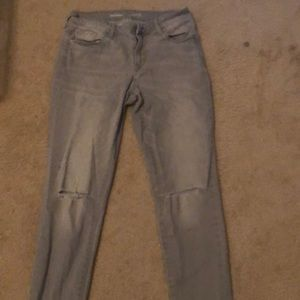 Distressed grey jeans